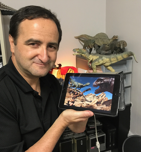 Bruce posing in front of toy dinos used in final image