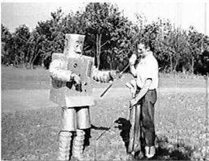 Alan Scott teaches golf to Mr. Rivets