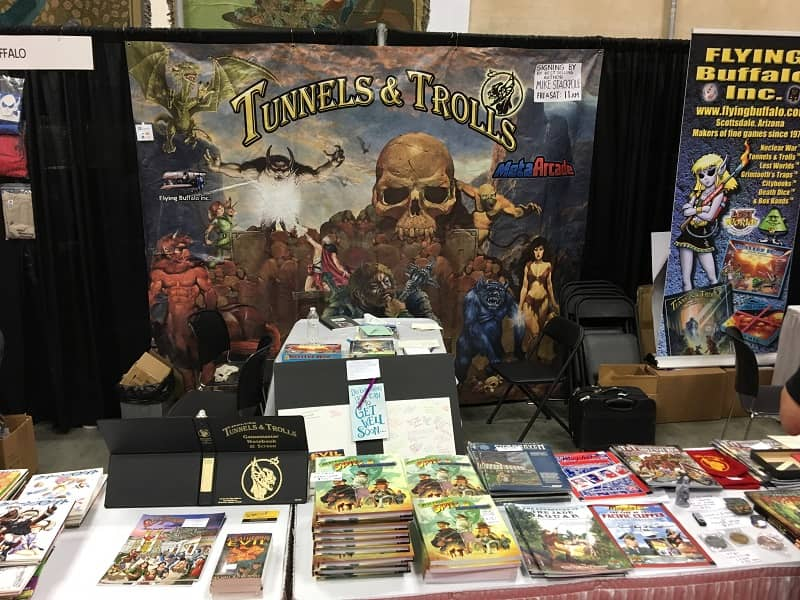 Flying Buffalo booth at Gen Con 2019, with Rick Loomis Get Well board-small